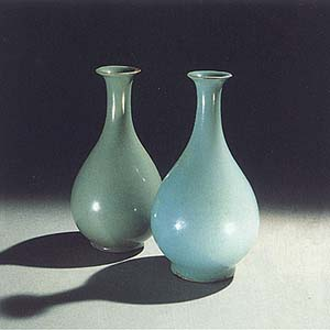 The bottle on the left is Korean celadon from the early 12th century, Koryo Dynasty. The bottle on the right is late 11th to early 12th century Chinese celadon.